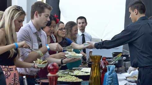 Guests enjoy a variety of fresh and delicious food at the President's Reception.