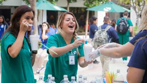 Nursing students enjoy root beer floats as part of a PTA fundraising activity in the courtyard.