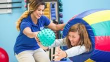 OTA students at our Orange County campus learn how to use dynamic techniques to help future clients strengthen or develop their gross motor skills.